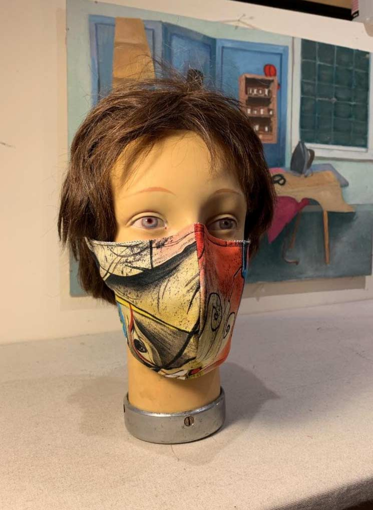 Picasso style mask with red, black and beige graphic design